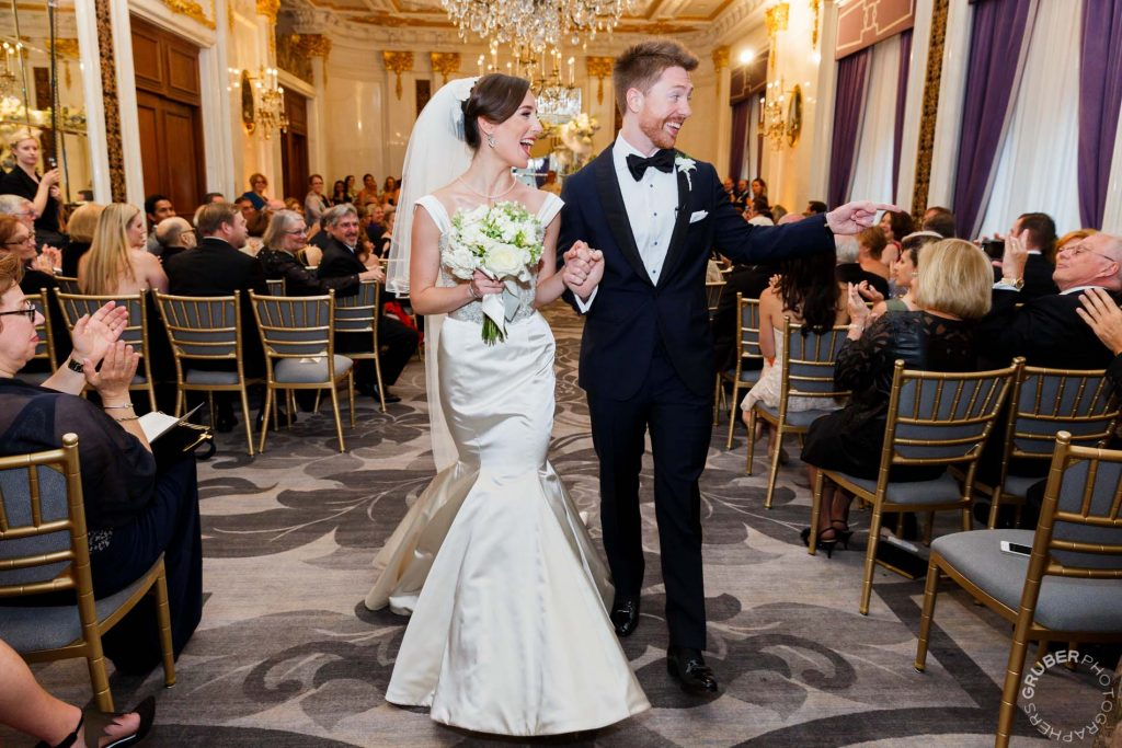 Groom celebrating his new bride