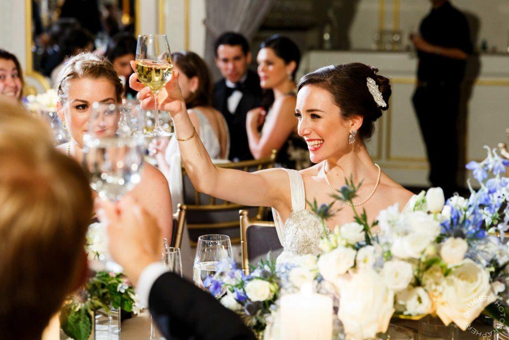Bride cheering at her reception