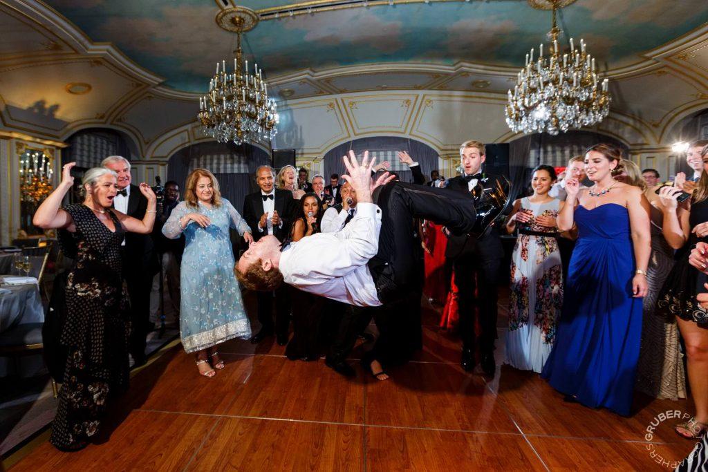 Wedding guest doing a backflip