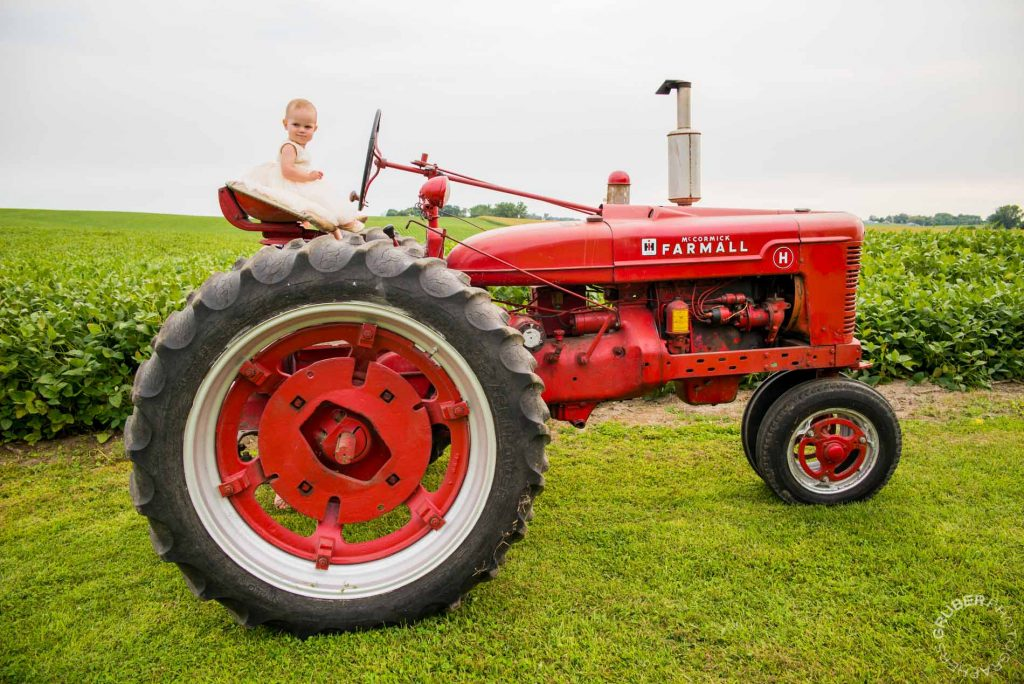 Baby on a McCormick Farmall Tractor