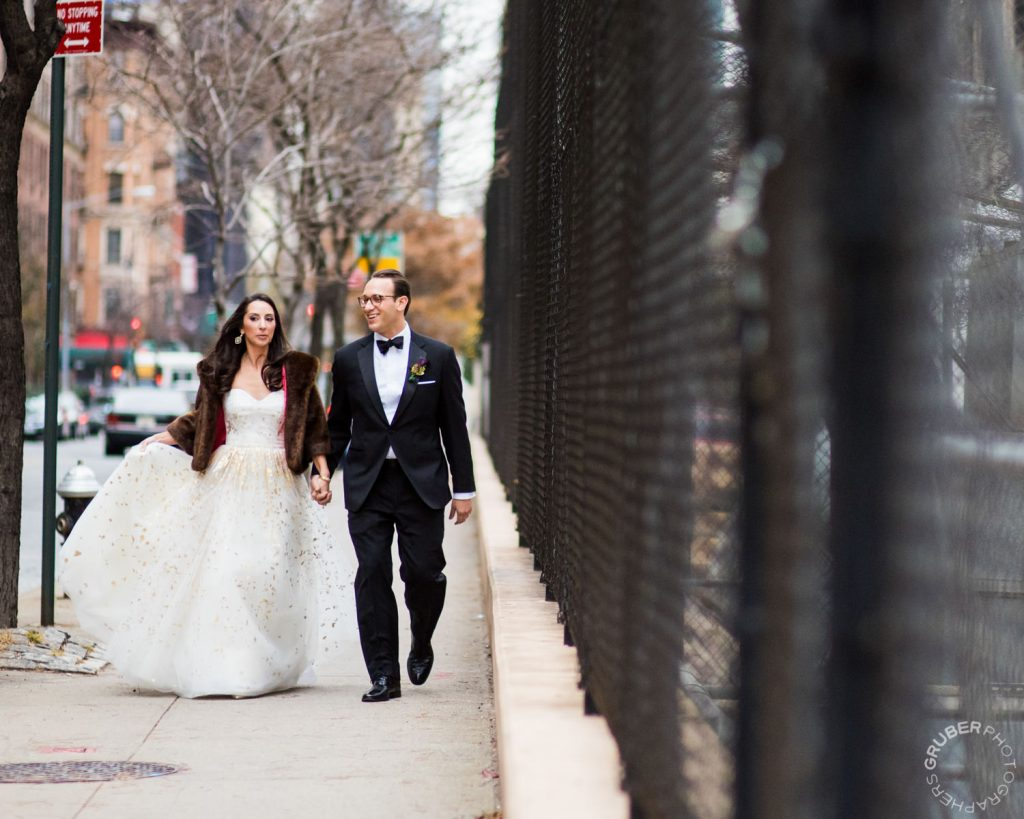 Bride and Groom taking a stroll during their winter wedding