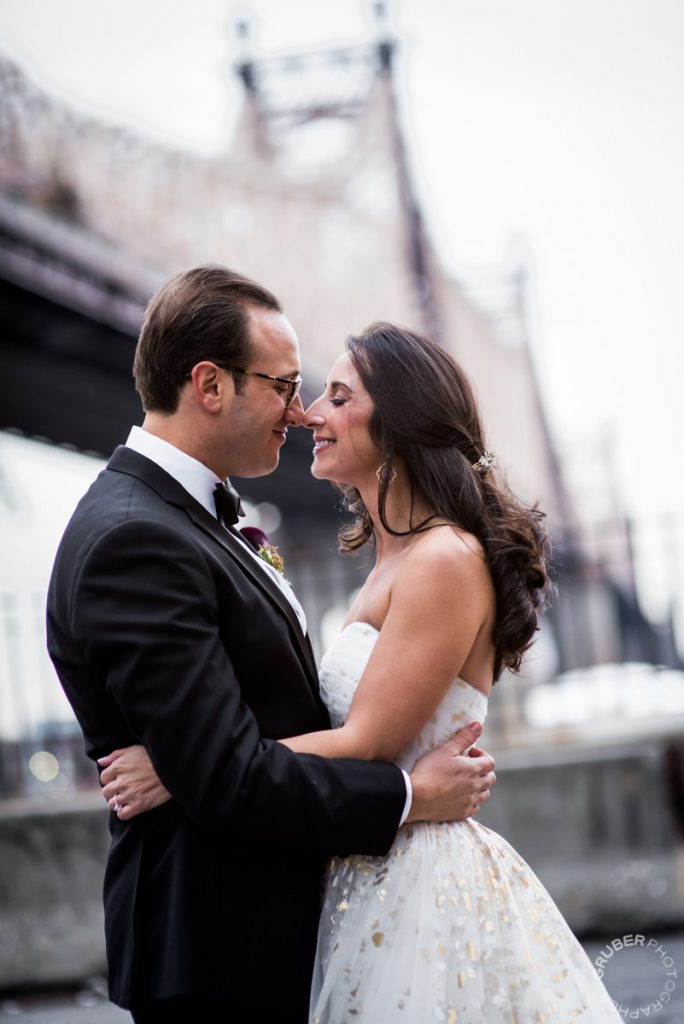 Bride and Groom Sharing a moment under the bridge in NYC