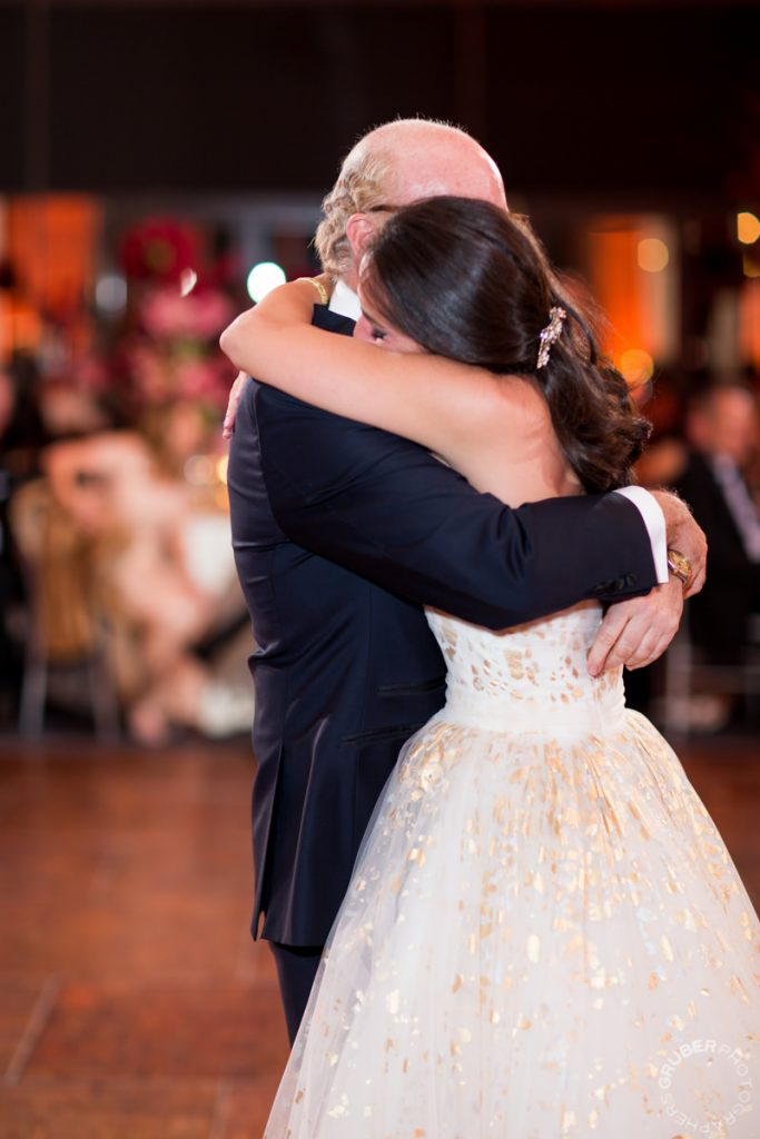 Bride in tears of joy while dancing with her father