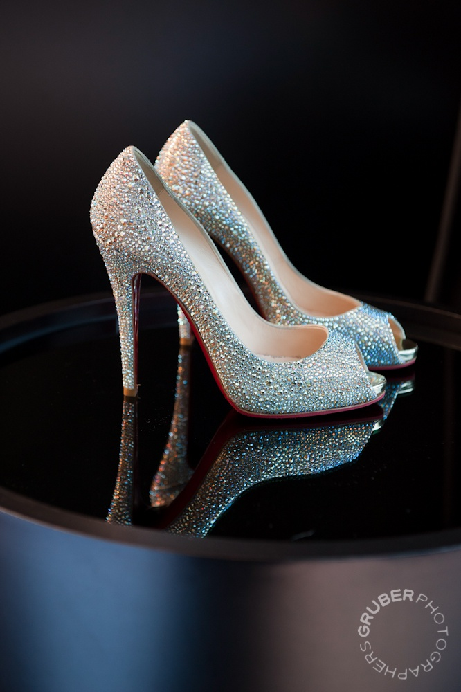 Christian Louboutin shoes on piano