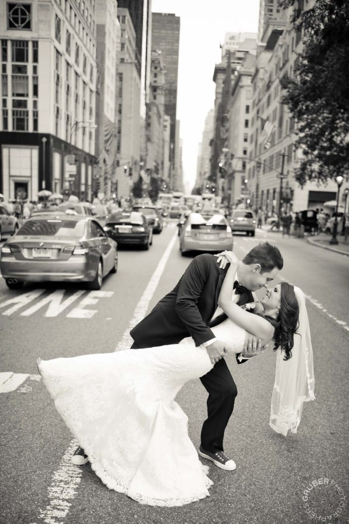 Husband dipping his bride in the streets of New York