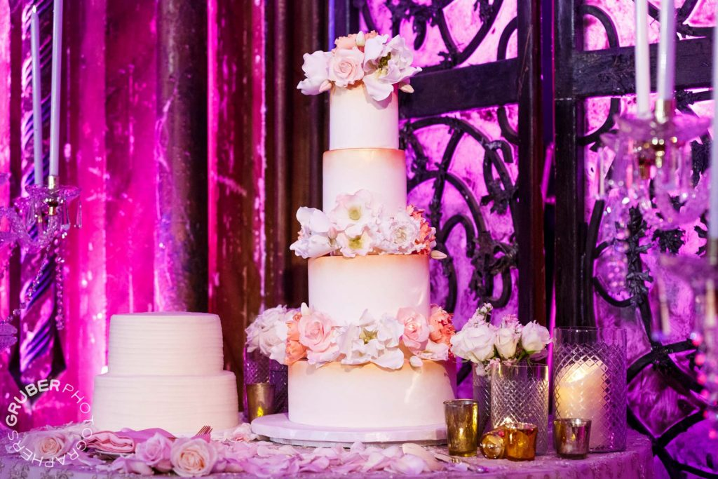 The wedding cake, decked in flowers