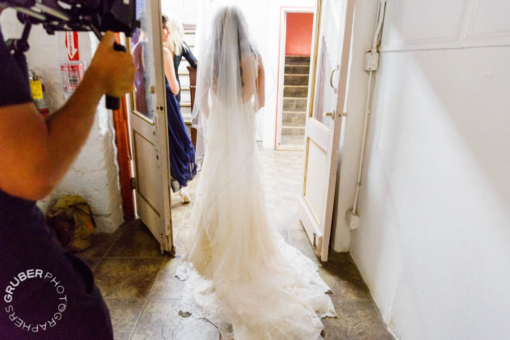 The big reveal of the bride in her beautiful David Tutera gown captured on video