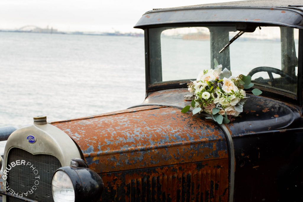 A vintage car overlooks the harbor