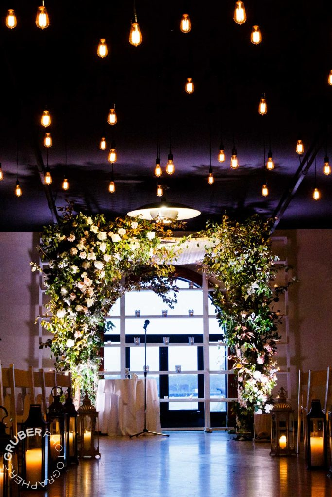 The aisle magically lined with lanterns