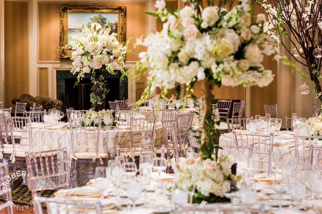 The tables set with gorgeous floral arrangements by Stefan's Flowers