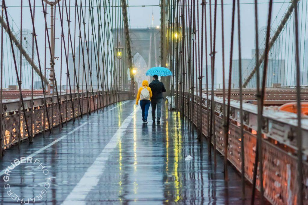 Couple Under Umbrella on Bridge
