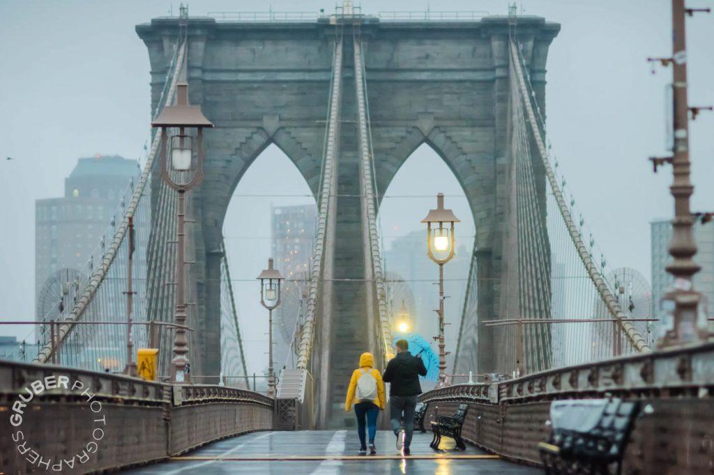 Couple in Rain Gear on Brooklyn Bridge