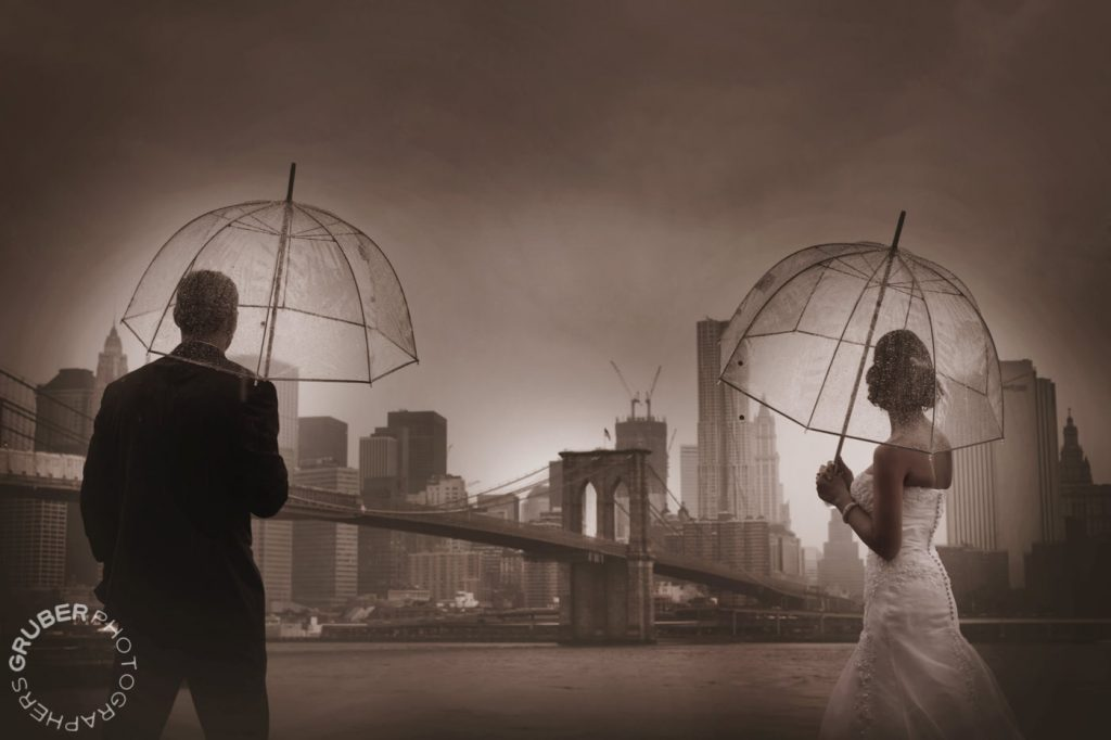 Couple Under Umbrellas Overlooking Manhattan