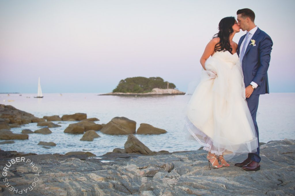 Married Couple Kissing on Rocks