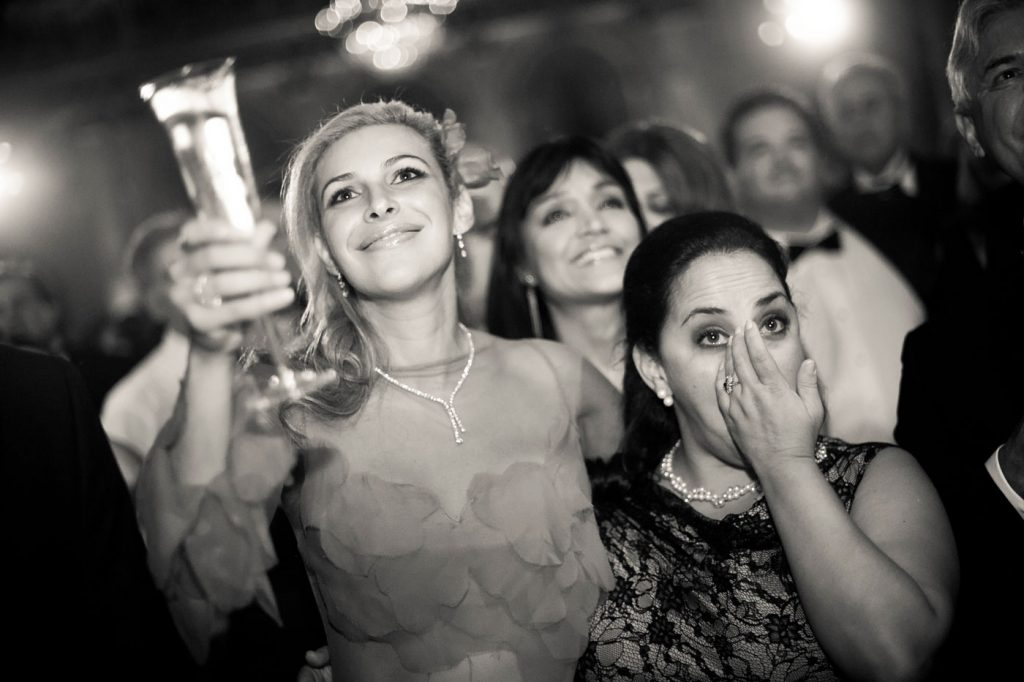 Bride and Wedding Guest Toasting
